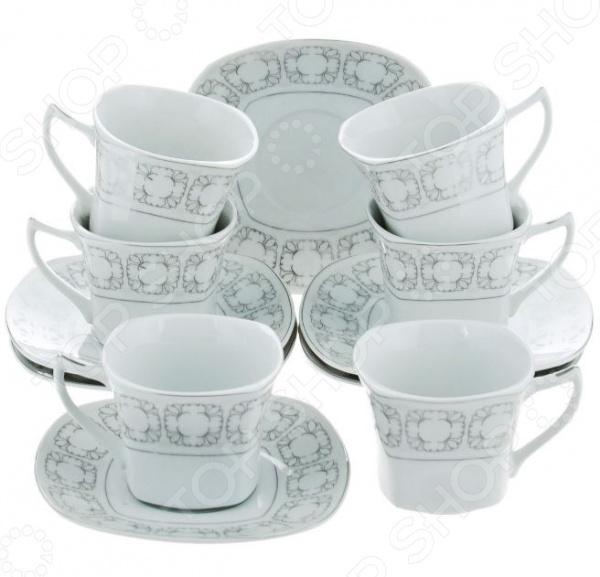 Чайный набор Bekker BK-5986Чайные и кофейные наборы<br>Чайный набор Bekker BK-5986 не просто станет прекрасным дополнением к набору кухонных принадлежностей, но и внесет яркий акцент в сервировку вашего стола. К тому же, он будет отличным приобретением или подарком для любителей чая и позволит превратить обычное чаепитие в настоящий ритуал. Посуда отличается стильным дизайном и великолепным качеством исполнения, изготовлена из высококачественного фарфора и украшена оригинальным рисунком. В комплект входят шесть чайных чашек с блюдцами. Набор упакован в красивую подарочную коробку.<br>