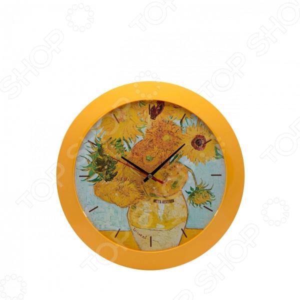 Часы настенные Mitya Veselkov «Подсолнухи»Часы настенные<br>Настенные часы это элегантный и неотъемлемый элемент дизайна любого помещения. Правильно подобранные часы позволяют внести в общий интерьерный ансамбль некоторую изюминку и легкий штрих индивидуальности, собственного стиля. Поэтому к подбору такого значимого и функционального украшения надо подходить с умом. Настенные часы от отечественного бренда Mitya Veselkov станут настоящей находкой для тех, кто следит за трендами современной моды, любит постоянные перемены и предпочитает новаторские решения взамен обыденной классике. Часы настенные Mitya Veselkov Подсолнухи отлично впишутся в интерьер вашей гостиной, спальни, кухни или детской комнаты. Корпус кварцевых часов выполнен из качественного пластика, который гарантирует не только их легкость, но и практичность, легкий монтаж и уход. Циферблат данной модели оформлен фрагментом знаменитой картины нидерландского художника Винсента Ван Гога Подсолнухи . Яркий и красочный дизайн без сомнения придется по душе поклонникам изобразительного искусства. Создайте неповторимую атмосферу уюта и комфорта с необычными настенными часами Mitya Veselkov Подсолнухи !<br>