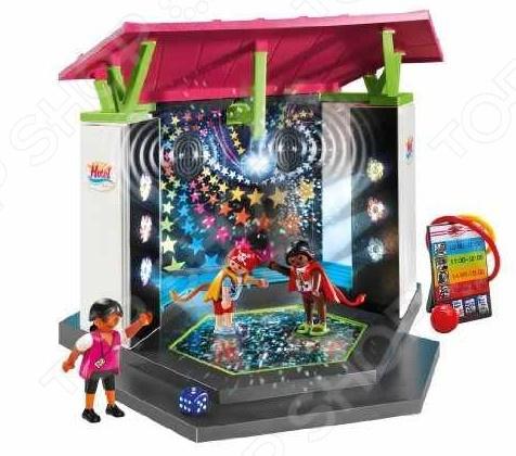 Детский клуб с танц площадкой Playmobil 5266pmДругие виды конструкторов<br>Отель:Детский клуб с танц площадкой Playmobil 5266pm станет великолепной игрушкой для ваших детей, которая доставит им огромное количество радостных минут и мгновений. Вас и всех окружающих, без сомнения, порадуют весёлые детские возгласы, во время интересной игры, а яркие, разнообразные цвета будут способствовать развитию у малыша чувства восприятия звука и цвета, и, что немаловажно, развитию моторики, координации движения, логику малыша. Позвольте ребёнку создать свой мир и наполнить его именно теми персонажами и элементами, которые ему больше всего нравятся. Подарите малышу радость игры в гибких и пластичных танцоров.<br>