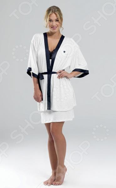 Халат BlackSpade 5763Халаты<br>Халат BlackSpade 5763 великолепный вариант для стильных современных женщин, которые предпочитают комфорт, красоту и удобство во всем. Легкий халат оформлен широкими рукавами и свободным покроем, не сковывающим движения. Изделие идеально подойдет для повседневной носки. Халат выполнен из качественного модала и обладает отличной воздухопроницаемостью и гигроскопичностью. В нем вы будете чувствовать комфортно как зимой, так и в более теплое время года. Благодаря тому, что изделие выполнено с незначительным добавлением эластана, он может похвастаться удивительной мягкостью, шелковистостью и приятными прикосновениями. Элегантный дизайн в мелкий горошек и контрастной отделкой делает халат не только комфортным, но и очень красивым. Эта практичная модель позволит вам выглядеть ярко и привлекательно, даже если вы находитесь дома!<br>