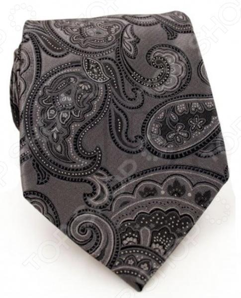 Галстук Mondigo 41027Галстуки. Бабочки. Воротнички<br>Галстук Mondigo 41027 завершающий штрих в образе солидного мужчины. Сегодня классический стиль в одежде приветствуется не только на работе в офисе. Многие люди предпочитают в качестве повседневной одежды костюм или рубашку с галстуком. Мужчина, выбирающий такой стиль в одежде, всегда выделяется среди окружающих и производит положительное первое впечатление. Кроме того, один и тот же галстук можно носить по-разному каждый день. Достаточно выбрать один из многочисленных типов узлов: аскот, балтус, кент, пратт и многие другие. Кстати, в интернете есть сайты, которые случайным образом предлагают вариант узла удобно, когда трудно определиться с выбором . Галстук изготовлен из шелка. Ткань довольно прочная, отличается роскошным блеском и приятная на ощупь. Края изделия обработаны лазерным методом.<br>