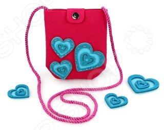 Набор для изготовления сумочки из фетра Color Puppy «Сердечки»Фетр. Войлок<br>Набор для изготовления сумочки из фетра Color Puppy Сердечки это отличный подарок маленькой принцессе. Во-первых, это оригинальный набор для рукоделия, с помощью которого девочка сможет своими руками создать полезный аксессуар. Работа с таким набором способствует развитию мелкой моторики рук, тренирует фантазию и усидчивость. Во-вторых, с такой сумочкой можно будет выходить на прогулку и выделяться оригинальным аксессуаром среди своих друзей.<br>