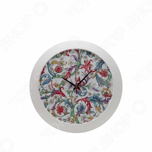 Часы настенные Mitya Veselkov «Райский сад»Часы настенные<br>Настенные часы это элегантный и неотъемлемый элемент дизайна любого помещения. Правильно подобранные часы позволяют внести в общий интерьерный ансамбль некоторую изюминку и легкий штрих индивидуальности, собственного стиля. Поэтому к подбору такого значимого и функционального украшения надо подходить с умом. Настенные часы от отечественного бренда Mitya Veselkov станут настоящей находкой для тех, кто следит за трендами современной моды, любит постоянные перемены и предпочитает новаторские решения взамен обыденной классике. Часы настенные Mitya Veselkov Райский сад отлично впишутся в интерьер вашей гостиной, спальни, кухни или детской комнаты. Корпус кварцевых часов выполнен из качественного пластика, который гарантирует не только их легкость, но и практичность, легкий монтаж и уход. Циферблат данной модели оформлен стильным и красивым дизайнерским принтом. Эксклюзивный дизайн изделия позволит подчеркнуть оригинальность интерьера вашего дома и выразить вашу индивидуальность, а яркая и сочная расцветка превратит часы в настоящий источник хорошего настроения и вдохновения. Создайте неповторимую атмосферу уюта и комфорта с необычными настенными часами Mitya Veselkov Райский сад !<br>