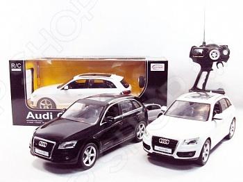 Машина на радиоуправлении Rastar AUDI Q5. В ассортиментеМашинки, мотоциклы, квадроциклы радиоуправляемые<br>Товар продается в ассортименте. Цвет изделия при комплектации заказа зависит от наличия цветового ассортимента товара на складе. Машина на радиоуправлении Rastar AUDI Q5 это шикарная модель, которая является копией настоящего автомобиля. Она изготовлена из пластика с элементами металла. У машинки открываются двери, двигаются колеса, а движение происходит в любую из четырех сторон. Машинка является отличным подарком для вашего ребенка. Игрушка выполнена с прекрасной детализацией, что позволит вашему ребенку изучить мелкие детали автомобиля. Во время игры с такой машинкой у ребенка развивается мелкая моторика рук, фантазия и воображение. Есть пульт для радиоуправления.<br>