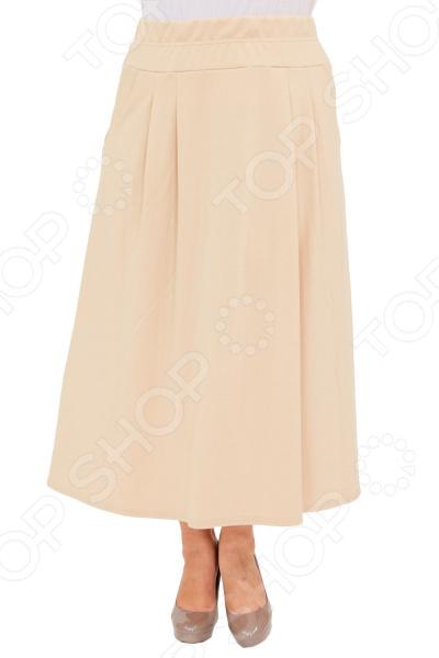 Юбка Матекс «Луина». Цвет: бежевыйЮбки<br>Юбка Матекс Луина прекрасная вещь для создания легкого женственного образа, которая идеально впишется в весенне-летний гардероб благодаря свободному крою и приятному материалу. Удобная юбка сделана из легкой ткани, поэтому прекрасно подойдет для повседневного использования.  Длинная юбка-клеш классического кроя.  Широкий пояс-резинка удобно сидит на талии и не ограничивает движений.  По бокам предусмотрено два кармана.  На фотографии модель представлена в сочетании с блузой Тутси . Юбка сшита из приятной на ощупь ткани 65 вискоза, 30 полиэстер, 5 лайкра . Материал не мнется, не скатывается и не линяет, быстро высыхает после стирки.<br>