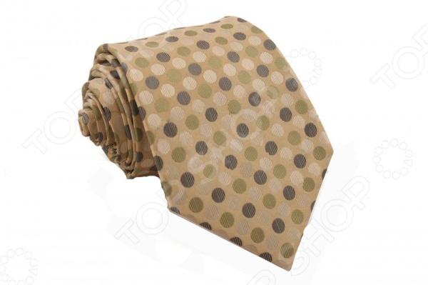 Галстук Mondigo 44110Галстуки. Бабочки. Воротнички<br>Галстук Mondigo 44110 это галстук из 100 шелка, украшен крупным фактурным горошком. Он подходит как для повседневной одежды, так и для эксклюзивных костюмов. Подберите галстук в соответствии с остальными деталями одежды и вы будете выглядеть идеально! В современном мире все большее распространение находит классический стиль одежды вне зависимости от типа вашей работы. Даже во время отдыха многие мужчины предпочитают костюм и галстук, нежели джинсы и футболку. Если вы хотите понравится девушке, то удивить ее своим стилем это проверенный метод от голливудских знаменитостей. Для того, чтобы каждый день выглядеть по-новому нет необходимости менять галстуки, можно сменить вариант узла, к примеру завязать:  узким восточным узлом, который подойдет для деловых встреч;  широким узлом Пратт , который прекрасно смотрится как на работе, так и во время отдыха;  оригинальным узлом Онассис , который удивит всех ваших знакомых своей неповторимый формой.<br>