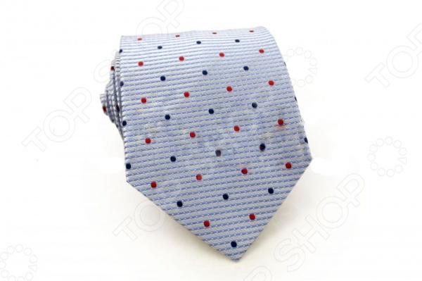 Галстук Mondigo 44471Галстуки. Бабочки. Воротнички<br>Галстук Mondigo 44471 это галстук из 100 шелка, украшен маленькими точками красного и синего цвета, края обработаны лазерным методом, а с обратной стороны прострочен шелковой ниткой. Он подходит как для повседневной одежды, так и для эксклюзивных костюмов. Подберите галстук в соответствии с остальными деталями одежды и вы будете выглядеть идеально! В современном мире все большее распространение находит классический стиль одежды вне зависимости от типа вашей работы. Даже во время отдыха многие мужчины предпочитают костюм и галстук, нежели джинсы и футболку. Если вы хотите понравится девушке, то удивить ее своим стилем это проверенный метод от голливудских знаменитостей. Для того, чтобы каждый день выглядеть по-новому нет необходимости менять галстуки, можно сменить вариант узла, к примеру завязать:  узким восточным узлом, который подойдет для деловых встреч;  широким узлом Пратт , который прекрасно смотрится как на работе, так и во время отдыха;  оригинальным узлом Онассис , который удивит всех ваших знакомых своей неповторимый формой.<br>