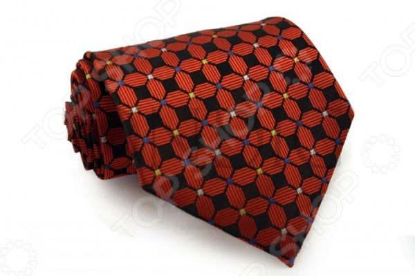 Галстук Mondigo 33289Галстуки. Бабочки. Воротнички<br>Галстук Mondigo 33289 станет важным дополнением гардероба каждого мужчины, ведь стильный и правильно подобранный галстук способен превратить повседневный классический образ мужчины в стильный и современный образ делового человека. Галстук выполнен из высококачественной микрофибры терракотового цвета и украшен изящным абстрактным принтом. Модель послужит прекрасным дополнением костюма и будет гармонично смотреться как в офисе, так и на официальных торжественных мероприятиях. В комплекте с галстуком карманный платок размером 23х23 см. Ширина у основания галстука составляет 8,5 см.<br>