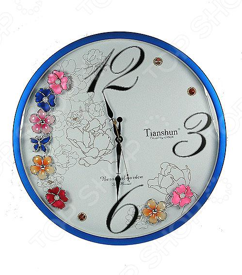 Часы настенные 148115Часы настенные<br>Часы уже давно перестали быть предметом исключительно практического назначения. Сегодня они являются еще и отличным элементом декора, который вполне может стать настоящей изюминкой вашего интерьера. Разнообразие форм, цветов и стилистических решений способны удовлетворить вкус даже самых требовательных и взыскательных покупателей. Часы настенные 148115 это сочетание непревзойденного качества и стильного современного дизайна. Они прекрасно впишутся в интерьер гостиной или спальни, добавив ему яркости и нетривиальности. Часы имеют круглую форму, выполнены из высококачественных материалов и декорированы оригинальным цветочным узором. Предусмотрен аналоговый способ отражения времени. Часы работают от батареек типа АА приобретаются отдельно .<br>