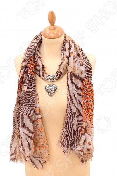 Шарф Milana Style «Амира»Шарфы<br>Шарф Milana Style Амира это шарф, который представляет собой известную и популярную модель для всех возрастов, идеально подходит для стиля casual. Обладательницы этого чудесного изделия, могут накинуть шарф на плечи, шею или же накинуть платок на голову обернув кончики во круг шеи, вы получите при этом шарф и шапку. Шарф яркой расцветки с анималистическим узором и бижу-украшением в виде сердца. Платок сделан из мягкой ткани Хлопок 50 ; Полиэстер 50 , украшен интересным узором. Изделие будет отлично гармонировать с любыми предметами вашего гардероба.<br>