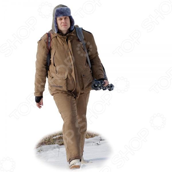 Костюм для охоты зимний NOVA TOUR Фокс v.2 предназначается для использования в холодное время года и способен защитить своего хозяина от морозов до -35 C. Нешуршащая ворсовая верхняя ткань и отсутствие застежек Velcro на костюме обеспечивают минимальный уровень шума, что несомненно обрадует любого охотника. Мягкая и приятная на ощупь флисовая подкладка прекрасно сохраняет тепло. Рукава обладают плотными манжетами, а брюки оканчиваются защитной муфтой, которая препятствует попаданию воды, снега, а также задуванию холодного воздуха. Талия и низ куртки регулируются эластичным шнуром, а большое количество карманов разного размера позволяет унести с собой все необходимое. Кроме того, брюки можно затянуть по ширине ноги или наоборот, накрыть сверху ботинки. Модель отличается от своего предшественника брюками высокой посадки, что обеспечивает защиту поясницы от холода. Ткань Micro Fibre Peach, а в качестве утеплителя используется Термо МАКС.