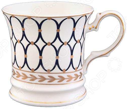 Кружка Elan Gallery «Узор»Кружки. Чашки<br>Кружка Elan Gallery Узор изготовлена из высококачественной керамики и дополнена декоративным рисунком. Посуда из этого материала позволяет максимально сохранить полезные свойства и вкусовые качества воды. Заварите крепкий, ароматный чай или кофе в представленной модели, и вы получите заряд бодрости, позитива и энергии на весь день! Классическая форма и универсальная цветовая гамма изделия позволят наслаждаться любимым напитком в атмосфере еще большей гармонии и эмоциональной наполненности. Преимущества кружки Elan Gallery Узор :  Изготовлена из керамики, что позволяет сохранить полезные свойства и вкусовые качества воды.  Украшена интересным рисунком.  Вмещает до 170 мл напитка.  Поставляется в подарочной упаковке. Кружка Elan Gallery Узор является прекрасным подарком для ваших любимых, родных и близких.<br>