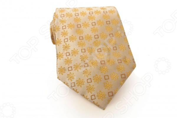 Галстук Mondigo 33308Галстуки. Бабочки. Воротнички<br>Галстук Mondigo 33308 это галстук из высококачественной микрофибры, украшен изящными геометрическими фигурами и узором. Он подходит как для повседневной одежды, так и для эксклюзивных костюмов. Подберите галстук в соответствии с остальными деталями одежды и вы будете выглядеть идеально! В современном мире все большее распространение находит классический стиль одежды вне зависимости от типа вашей работы. Даже во время отдыха многие мужчины предпочитают костюм и галстук, нежели джинсы и футболку. Если вы хотите понравится девушке, то удивить ее своим стилем это проверенный метод от голливудских знаменитостей. Для того, чтобы каждый день выглядеть по-новому нет необходимости менять галстуки, можно сменить вариант узла, к примеру завязать:  узким восточным узлом, который подойдет для деловых встреч;  широким узлом Пратт , который прекрасно смотрится как на работе, так и во время отдыха;  оригинальным узлом Онассис , который удивит всех ваших знакомых своей неповторимый формой.<br>