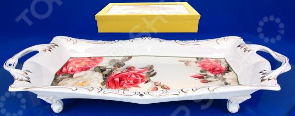 Блюдо на ножках Elan Gallery «Вальс цветов»Сервировочные блюда и тарелки<br>Блюдо на ножках Elan Gallery Вальс цветов красочная посуда на 4-х ножках с ручками для переноски, которая внесет разнообразие в сервировку кухонных принадлежностей. Посуда имеет нестандартную форму, при этом, предоставляя возможность с легкостью извлечь продукт. Материал абсолютно безопасен и не вступает в реакцию с продуктами, а так же не влияет на запах и вкус готового изделия.<br>