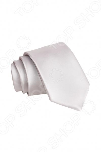 Галстук Mondigo 34930Галстуки. Бабочки. Воротнички<br>Галстук Mondigo 34930 станет важным дополнением гардероба каждого мужчины, ведь стильный и правильно подобранный галстук способен превратить повседневный классический образ мужчины в стильный и современный образ делового человека. Галстук выполнен из высококачественной микрофибры белого цвета. Модель послужит прекрасным дополнением костюма и будет гармонично смотреться как в офисе, так и на официальных торжественных мероприятиях. Ширина у основания галстука составляет 7 см.<br>