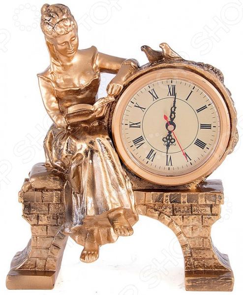Часы настольные «Дама с книгой» 59417Часы настольные<br>Часы настольные Дама с книгой 59417 изделие, удивительным образом сочетающее в себе высокое качество, роскошный дизайн и практичность. Очень удобно, когда часы всегда под рукой. Они особенно пригодятся в рабочем кабинете или гостиной вы сможете легко контролировать свою деятельность и точно не опоздаете на важную встречу! Благодаря красивейшей бронзовой расцветке часы легко впишутся в любой интерьер. Они будут идеально гармонировать с мебелью и текстилем, а дизайн под старину внесет в помещение особый шарм и нотки роскоши. Циферблат с римскими цифрами и тремя стрелками на бежевом фоне. Часы работают от батареек типа АА в комплект не входят . В качестве рекомендации по уходу регулярное удаление пыли мягкой сухой тканью.<br>