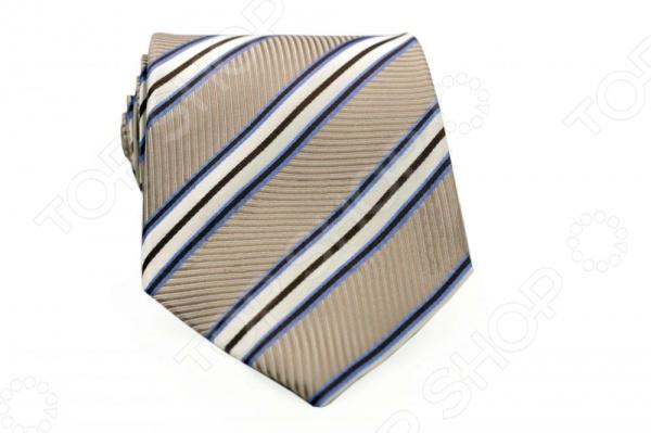 Галстук Mondigo 44459Галстуки. Бабочки. Воротнички<br>Галстук Mondigo 44459 - классический шелковый галстук, который является одной из важнейших и незаменимых деталей в гардеробе каждого мужчины. Правильно подобранный галстук позволяет эффектно выделить выбранный вами стиль, подчеркнуть изысканность и уникальность его владельца. Стильный галстук ручной работы выполнен из натурального 100 шелка приятного голубого цвета и оформлен оригинальным фактурным рисунком с диагональными полосами разной ширины и оттенков. Обратная сторона изделия прострочена специальной шелковой ниткой, что позволяет самостоятельно регулировать длину изделия. Этот стильный галстук эффектно дополнит любой деловой костюм и будет уместен как в офисе, так и на торжественных мероприятиях. С этим галстуком даже самый строгий костюм будет выглядеть эффектно. Ширина у основания - 8,5 см.<br>