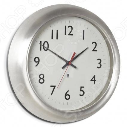 Часы настенные Umbra StationЧасы настенные<br>Часы настенные Umbra Station станут украшением как комнаты у вас дома, так и офиса. Часы выполнены из алюминия с полированным покрытием. Они отлично впишутся в минималистичный интерьер или стиль лофт. Umbra это компания, которая уже более 30 лет занимается производством оригинальных домашних аксессуаров. Сегодня Umbra признана в 118 странах мира, в том числе и в России, одним из лидеров в области оригинального, доступного и простого современного дизайна для дома и интерьера. Umbra создает и производит уникальные вещи превосходного качества для оформления интерьера гостиных, спален, кухонь и ванных комнат. Дизайн часов Paul Rawan.<br>