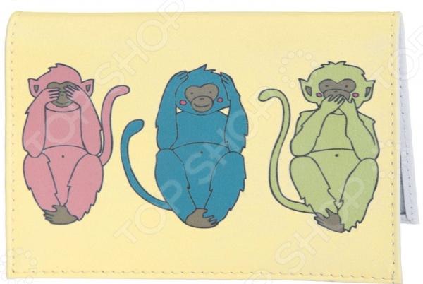 Обложка для автодокументов кожаная Mitya Veselkov «Три мудрых обезьяны на светло-желтом»Обложки для автодокументов<br>Обложка для автодокументов кожаная Mitya Veselkov Три мудрых обезьяны на светло-желтом незаменимый аксессуар для любого автовладельца. Сложить бесконечное множество необходимых документов на авто в портмоне или кошелек бывает не всегда удобно, а носить специальную сумочку рискуешь её где-нибудь обязательно забыть или потерять. Такой компактный и практичный аксессуар поможет вам с комфортом и организованно разложить такие документы как: водительские права, документы на машину или доверенность, страховочный лист и прочее. Особенность обложки заключается в её удивительной вместительности и оригинальном дизайне от популярного российского бренда Mitya Veselkov, который отличается своей креативностью и запоминающимися принтами. Обложка для автодокументов кожаная Mitya Veselkov Три мудрых обезьяны на светло-желтом выполнена из натуральной кожи. Этот материал со временем не рвется, не истирается и не трескается, поэтому прослужит долгое время без малейших нареканий. Оригинальный дизайн с забавным принтом в виде трех очаровательных обезьянок украшает внешнюю сторону обложки и заставит улыбнуться не только вас, но и строгих блюстителей закона. Такой аксессуар идеально подчеркнет вашу индивидуальность и внимательность к мелочам, а также станет стильным подарком для ваших друзей и близких.<br>