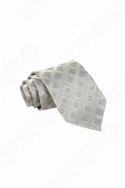 Галстук Mondigo 44831Галстуки. Бабочки. Воротнички<br>Галстук Mondigo 44831 - красивая и, пожалуй, самая важная деталь мужского гардероба. Стильный и правильно подобранный галстук способен творить чудеса, превращая повседневный классический образ мужчины в стильный и современный образ делового человека. Элегантный галстук Mondigo выполнен из высококачественного натурального шелка светло-серого с фактурным геометрическим принтом. Эта модель придется по вкусу деловым мужчинам, которые ценят классику, практичность и изысканность. Изделие послужит прекрасным дополнением любого костюма и будет гармонично смотреться как в офисе, так и на торжественных мероприятиях. С галстуком от бренда Mondigo вы точно не останетесь незамеченными. Ширина основания галстука составляет 8,5 см.<br>