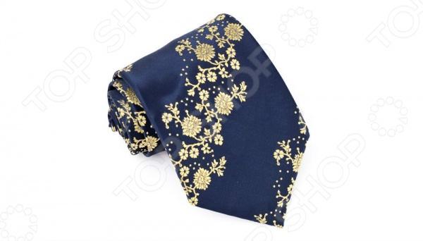 Галстук Mondigo 33953Галстуки. Бабочки. Воротнички<br>Галстук Mondigo 33953 это галстук из высококачественной микрофибры, украшен оригинальным цветочным орнаментом. Он подходит как для повседневной одежды, так и для эксклюзивных костюмов. Подберите галстук в соответствии с остальными деталями одежды и вы будете выглядеть идеально! В современном мире все большее распространение находит классический стиль одежды вне зависимости от типа вашей работы. Даже во время отдыха многие мужчины предпочитают костюм и галстук, нежели джинсы и футболку. Если вы хотите понравится девушке, то удивить ее своим стилем это проверенный метод от голливудских знаменитостей. Для того, чтобы каждый день выглядеть по-новому нет необходимости менять галстуки, можно сменить вариант узла, к примеру завязать:  узким восточным узлом, который подойдет для деловых встреч;  широким узлом Пратт , который прекрасно смотрится как на работе, так и во время отдыха;  оригинальным узлом Онассис , который удивит всех ваших знакомых своей неповторимый формой.<br>