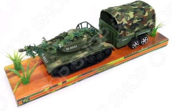 Танк инерционный Shantou Gepai с прицепом M60A3-5PМашинки<br>Танк инерционный Shantou Gepai с прицепом M60A3-5P оригинальная модель танка, выполненная из качественных и прочных материалов. Имеет прицеп и дополнительные аксессуары. Иннерционный внутренний мезанизм позволит откатывать машинку назад для того, чтобы затем она ехала автоматически вперед. Детализированное оформление понравится каждому мальчишке и позволит разыграть множество интересных сценариев, раскрывая свое воображение.<br>