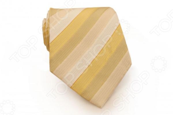 Галстук Mondigo 44486Галстуки. Бабочки. Воротнички<br>Галстук Mondigo 44486 - элегантный мужской галстук, ручной работы из шелка, который обладает хорошими гигиеническими свойствами и особым блеском. Галстук бежевого цвета, из фактурной ткани имеет оригинальный дизайн в виде диагональных полосок. Края галстука обработаны лазерным методом. Такой стильный галстук будет очаровательно смотреться с мужскими рубашками темных и светлых оттенков. Дизайн дополнит деловой стиль и придаст изюминку к образу строгого делового костюма.<br>
