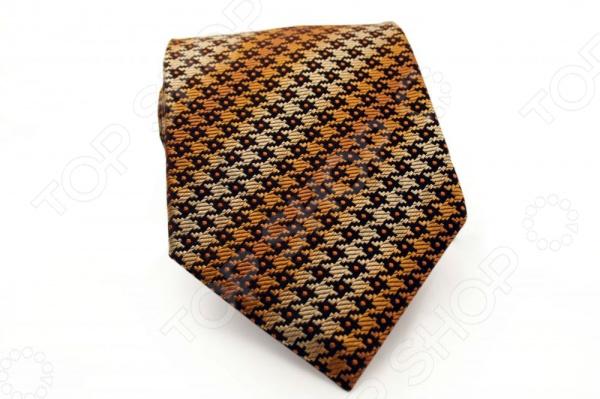Галстук Mondigo 44540Галстуки. Бабочки. Воротнички<br>Галстук Mondigo 44540 - яркий стильный шелковый галстук, который является одной из важнейших и незаменимых деталей в гардеробе каждого мужчины. Правильно подобранный галстук позволяет эффектно выделить выбранный вами стиль, подчеркнуть изысканность и уникальность его владельца. Стильный галстук выполнен из натурального 100 шелка коричневого цвета, оригинальная фактурная вышивка контрастных цветов придает изделию дополнительную изысканности и стиль. Этот стильный галстук эффектно дополнит любой деловой костюм и будет уместен как в офисе, так и на торжественных мероприятиях. С этим галстуком даже самый строгий костюм будет выглядеть стильно и современно. Особенности галстука Mondigo 44540:  для большей прочности края галстука обработаны лазерным методом;  ручная работа;  ширина у основания - 8,5 см.<br>