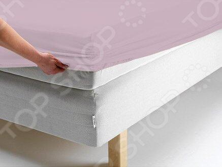 Простыня на резинке Ecotex трикотажная. Цвет: розовыйПростыни<br>Простыня на резинке Ecotex трикотажная это трикотажная простыня, которая обеспечит максимальный комфорт во время сна и поможет создать в спальне настоящий уют. Простыня изготовлена из высококачественного хлопка, что гарантирует здоровый и спокойный сон в любое время года, ведь этот материал обладает отличными дышащими , впитывающими и гигиеническими свойствами. Также простыня снабжена резинкой по всему периметру, поэтому отлично держится на матрасе и ее не надо часто поправлять. Главное это подобрать размер простыни под ваш матрас, в противном случае вам не избежать скатывания материала. Простыню легко гладить, но это не обязательно, ведь поверхность идеально ровная и гладкая даже после стирки.<br>