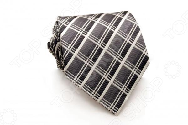 Галстук Mondigo 44272Галстуки. Бабочки. Воротнички<br>Галстук Mondigo 44272 - стильный мужской галстук ручной работы, выполненный из шелка, который обладает хорошими гигиеническими свойствами и особым блеском. Галстук серого цвета, украшен тонкими диагональными полосками. Края галстука обработаны лазерным методом. На обратной стороне галстука находится простроченная шелковая нитка, которая позволяет регулировать длину изделию. Такой стильный галстук будет очаровательно смотреться с мужскими рубашками светлых оттенков. Необычный дизайн дополнит деловой стиль и придаст изюминку к образу строгого делового костюма.<br>