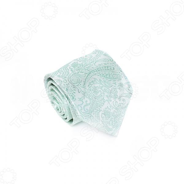 Галстук Mondigo 34644Галстуки. Бабочки. Воротнички<br>Галстук Mondigo 34644 - стильный мужской галстук, выполненный из микрофибры, которая обладает высокой устойчивостью и выдерживает богатую палитру оттенков. Галстук белого цвета, украшен оригинальным светло-бирюзовым узором пейсли. Этот аксессуар светлого оттенка подходит для корпоративных мероприятий и молодежных вечеров. Также стильный галстук будет очаровательно смотреться с мужскими рубашками темных и светлых оттенков. Упакован галстук в специальный чехол для аккуратной транспортировки. Дизайн дополнит деловой стиль и придаст изюминку к образу строгого делового костюма.<br>