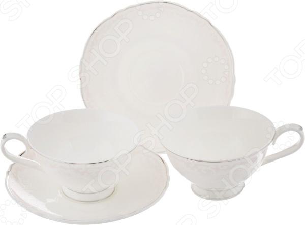 Чайная пара Elan Gallery «Розовый шик»Чайные и кофейные пары<br>Каждая хозяйка знает насколько важна в кулинарии сервировка и правильная подача блюд. От того как блюдо оформлено, в какой посуде подано и как смотрится на тарелке, зависит едва ли не половина вашего успеха. Набор из 2-х чайных пар Elan Gallery Розовый шик станет отличным дополнением к набору посуды и прекрасно подойдет для сервировки стола. Посуда выполнена из высококачественной керамики и украшена оригинальным розовым узором. В набор входят две чашки с блюдцами.<br>