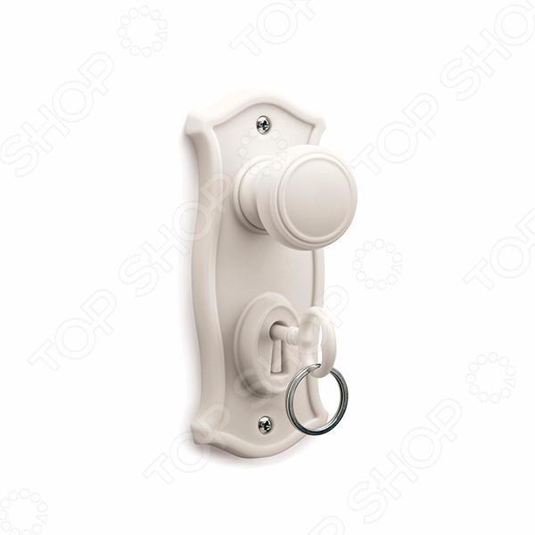 Держатель для ключей OTOTO DoorManКлючницы стационарные<br>Держатель для ключей OTOTO DoorMan функциональное и стильное дополнение к вашему домашнему интерьеру. Теперь вам больше не придется каждый раз, уходя на работу, искать оставленные где-то ключи. Просто расположите этот необычный держатель рядом с входной дверью, и ваши ключи всегда будут лежать на одном и том же месте. Пластиковая замочная скважина оснащена съемным держателем для ключей и крючком для сумок и одежды. Держатель легко крепится с помощью шурупов к любому удобному для вас месте.<br>