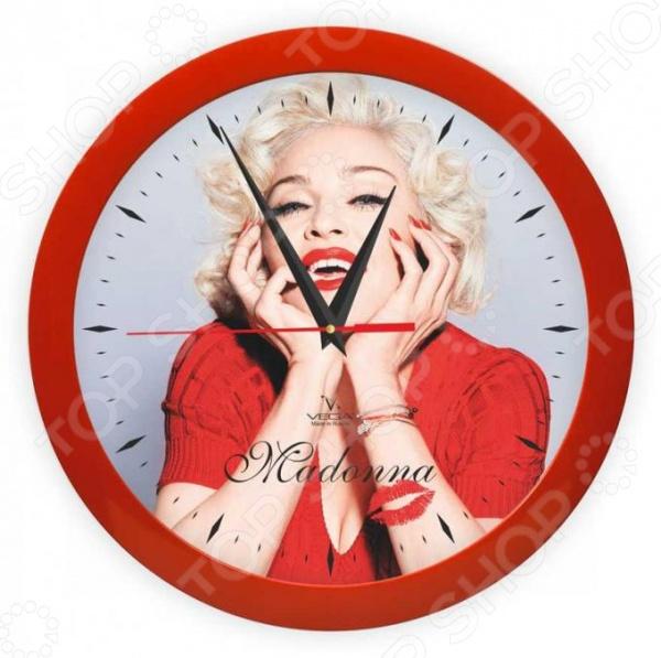 Часы настенные Вега П 1-1/7-283 «Мадонна»Часы настенные<br>Настенные часы это элегантный и неотъемлемый элемент дизайна любого помещения. Правильно подобранные часы позволяют внести в общий интерьерный ансамбль некоторую изюминку и легкий штрих индивидуальности, собственного стиля. Поэтому к подбору такого значимого и функционального украшения надо подходить с умом. Настенные часы от бренда Вега настоящей находкой для тех, кто следит за трендами современной моды. Часы настенные Вега П 1-1 7-283 Мадонна отлично впишутся в интерьер вашей гостиной, спальни, кухни или детской комнаты. Корпус кварцевых часов выполнен из качественного пластика, который гарантирует не только их легкость, но и практичность, легкий монтаж и уход. Циферблат данной модели оформлен стильным и красивым фото популярный певицы Мадонны. Эксклюзивный дизайн изделия позволит подчеркнуть оригинальность интерьера вашего дома и выразить вашу индивидуальность, а яркая и сочная расцветка превратит часы в настоящий источник хорошего настроения и вдохновения.<br>