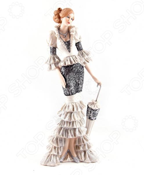 Статуэтка «Мисс Элегантность»Статуэтки и фигурки<br>Статуэтка Мисс Элегантность изысканный декоративный элемент для вашего дома. Изделие поможет внести завершающий штрих в интерьер любой комнаты, ведь уют складывается из мелочей. Эта статуэтка также может быть использована при сервировке праздничного стола в качестве декоративной составляющей. Кроме того, если вы желаете подобрать памятный подарок близкому человеку, то эта милая вещица прекрасно подойдет. Статуэтка выполнена из полистоуна. Это искусственный камень, сочетающий в себе массу полезных свойств. Материал экологичен, он абсолютно безопасен для человека и окружающей среды. Полистоун нейтрален к воздействию влаги и воздуха, а также слабых щелочных растворов; не впитывает запахи и влагу; устойчив к воздействию пищевых красителей. Материал не требует особого ухода, достаточно регулярно удалять пыль сухой мягкой тканью.<br>