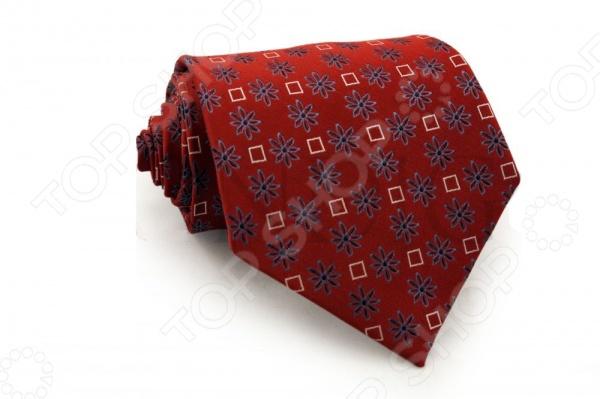 Галстук Mondigo 33294Галстуки. Бабочки. Воротнички<br>Галстук Mondigo 33294 станет важным дополнением гардероба каждого мужчины, ведь стильный и правильно подобранный галстук способен превратить повседневный классический образ мужчины в стильный и современный образ делового человека. Галстук выполнен из высококачественной микрофибры красного цвета и украшен изящными геометрическими фигурами и красивым узором. Модель послужит прекрасным дополнением костюма и будет гармонично смотреться как в офисе, так и на официальных торжественных мероприятиях. В комплекте с галстуком карманный платок размером 23х23 см. Ширина у основания галстука составляет 8,5 см.<br>