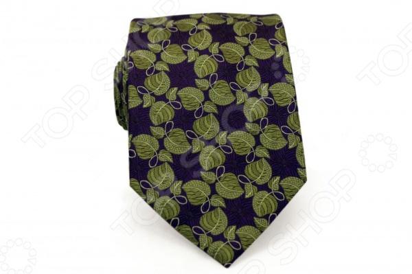 Галстук Mondigo 44753Галстуки. Бабочки. Воротнички<br>Галстук Mondigo 44753 - стильный мужской галстук, выполненный из шелка, который обладает хорошими гигиеническими свойствами и особым блеском. Галстук темно-зеленого цвета, украшен изумительным цветочным принтом. Края галстука обработаны лазерным методом. На обратной стороне галстука находится простроченная шелковая нитка, которая позволяет регулировать длину изделию. Такой стильный галстук будет очаровательно смотреться с мужскими рубашками темных и светлых оттенков. Необычный дизайн дополнит деловой стиль и придаст изюминку к образу строгого делового костюма.<br>