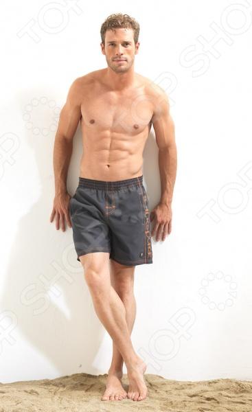 Шорты мужские пляжные BlackSpade 8002 станут отличным дополнением вашего пляжного гардероба! Пояс на резинке будет плотно держать шорты на теле, что позволит активно двигаться, играя в пляжные игры. Изделие выполнено из полиэстера, потому легко стирается, не садится и не деформируется.