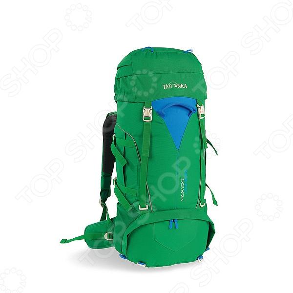Рюкзак туристический Tatonka Yukon JuniorТуристические рюкзаки и аксессуары<br>Рюкзак Tatonka Yukon Junior это отличный рюкзак, который подходит для туристических походов, отдыха и развлечений на природе. Он отличается большой функциональностью, практичностью и удобством использования. Высококачественные материалы изготовления обеспечивают надежность и позволяют переносить груз, объемом до 32 литров, чего вполне достаточно для того, чтобы взять с собой все необходимое. Продуманное расположение отделений внутри и удобные карманы снаружи способствуют наиболее рациональному распределению груза, обеспечивая, тем самым, снижение нагрузки на спину переносящего рюкзак человека. К его основным особенностям относятся:  Система переноски Y1-System;  Раздельные верхнее и нижнее отделения;  Фиксация треккинговых палок;  Регулируемые лямки S-образной анатомической формы;  Нагрудный ремень со свистком;  Боковые сетчатые карманы;  Светоотражающие полоски. Позаботьтесь заранее о том, чтобы ваша экипировка была максимально качественной и любой ваш поход станет намного легче и интереснее.<br>