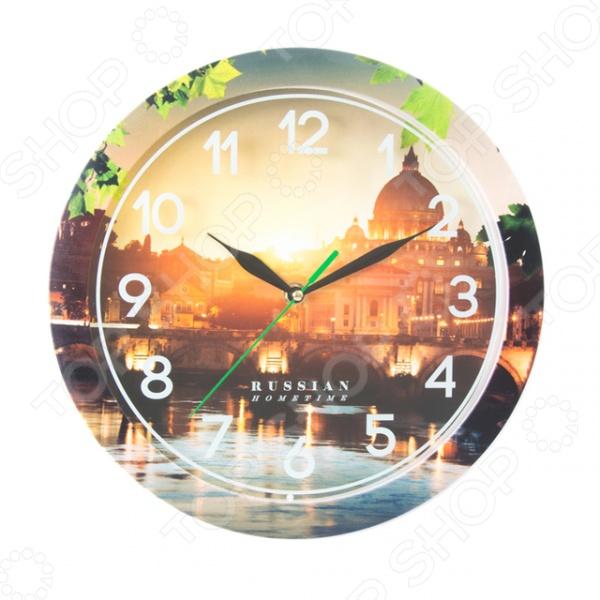 Часы настенные Вега П 1-263/7-263 «Мост с арками»Часы настенные<br>Настенные часы это элегантный и неотъемлемый элемент дизайна любого помещения. Правильно подобранные часы позволяют внести в общий интерьерный ансамбль некоторую изюминку и легкий штрих индивидуальности, собственного стиля. Поэтому к подбору такого значимого и функционального украшения надо подходить с умом. Настенные часы от бренда Вега настоящей находкой для тех, кто следит за трендами современной моды. Часы настенные Вега П 1-263 7-263 Мост с арками отлично впишутся в интерьер вашей гостиной, спальни, кухни или детской комнаты. Корпус кварцевых часов выполнен из качественного пластика, который гарантирует не только их легкость, но и практичность, легкий монтаж и уход. Циферблат данной модели оформлен стильным, ярким фото с впечатляющим городским пейзажем. Эксклюзивный дизайн изделия позволит подчеркнуть оригинальность интерьера вашего дома и выразить вашу индивидуальность, а яркая и сочная расцветка превратит часы в настоящий источник хорошего настроения и вдохновения.<br>