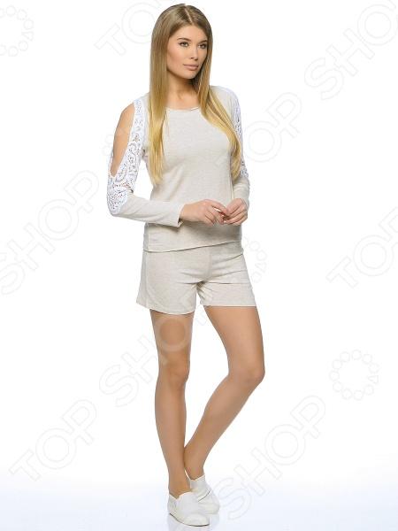 Джемпер домашний Milliner 16527. Цвет: кремовыйДомашние комплекты<br>Джемпер домашний Milliner 16527 предназначен специально для женщин. Модель с округлым вырезом горловины и длинными рукавами отлично подойдет для ежедневной носки по дому. Рукава оригинально оформлены плетеным кружевом. Джемпер будет гармонично смотреться с шортами или леггинсами из этой же серии. Благодаря новой технологии, абсорбция влаги в точке контакта ткани с телом происходит намного быстрей. Джемпер домашний Milliner 16527 изготовлен из 100 вискозы. Данный материал обладает целым рядом отличных потребительских свойств: воздухопроницаемость, гигроскопичность, мягкость, устойчивость к истиранию. Изделие крайне практично оно не деформируется, не садится и не линяет даже после множества стирок. На предприятиях производителя используется высокотехнологичное современное оборудование, отвечающее всем мировым стандартам и обеспечивающее высокое качество продукции.<br>