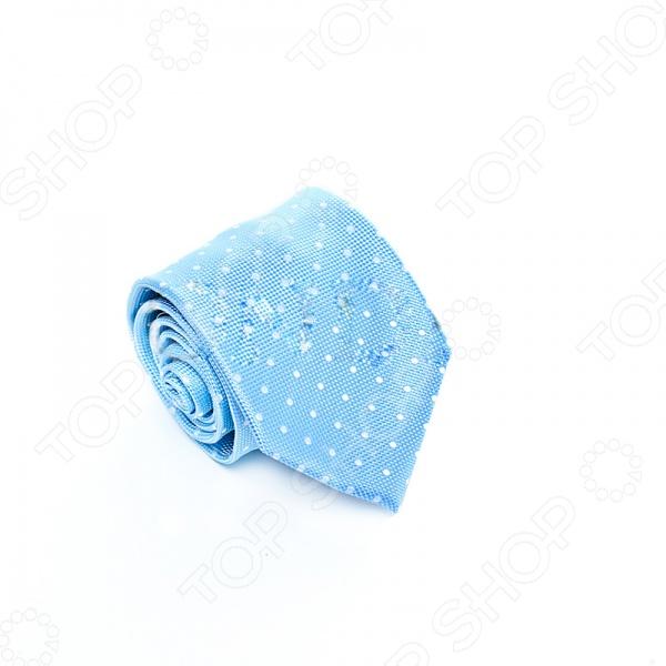 Галстук Mondigo 34655Галстуки. Бабочки. Воротнички<br>Галстук - важный элемент гардероба в жизни каждого мужчины. Сегодня сложно себе представить современного делового мужчину без галстука и это не удивительно, ведь именно галстук является главным атрибутом делового стиля. Не редко, для делового мужчины галстук - одна из немногих деталей, которая позволяет выразить свою индивидуальность, особенно в случаях, когда необходимо соблюдать строгий дресс-код. Однако, галстук уже давно вышел за пределы деловой сферы. Сегодня многие мужчины предпочитающие стиль кэжуал, так же активно прибегают к помощи различных галстуков для создания своего уникального образа. Галстуки стали очень разнообразными как по виду и цвету, так и по форме и материалу изготовления, благодаря этому их можно активно носить не только в офис и на деловых встречах, но даже на отдыхе и в повседневной жизни. Галстук Mondigo 34655 - оригинальная модель, которая станет завершающим штрихом в образе солидного мужчины. Правильно подобранный галстук позволяет эффектно выделить выбранный вами стиль, подчеркнуть изысканность и уникальность его владельца. Светлый и в тоже время очень нежный оттенок этого галстука говорит о том, что он больше подходит для торжественных мероприятий. Хотя вы всегда можете одеть его, скажем, на свою работу, если у вас приподнятое настроение. Ширина у основания 8,5 см.<br>
