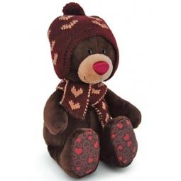 фото Мягкая игрушка Orange Choco «Медведь сидячий в вязаной шапке с сердечками». Размер: 30 см