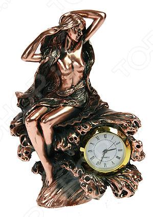 Часы настольные «Девушка» 127566Часы настольные<br>Часы настольные Девушка 127566 это не просто милая деталь интерьера, но и самая необходимая вещь для планирования дня! Представить свою жизнь без часов невозможно, особенно в современном мире, где на счету каждая минута. Настольные часы помогут подчеркнуть индивидуальность вашего интерьера, вы можете подобрать подходящую модель для каждой комнаты. Кварцевый механизм очень надёжен, питание происходит от батарейки типа АА. За часами очень просто ухаживать, достаточно протереть сухой тряпочкой и часы будут как новые, идеально подойдёт ткань из микрофибры.<br>