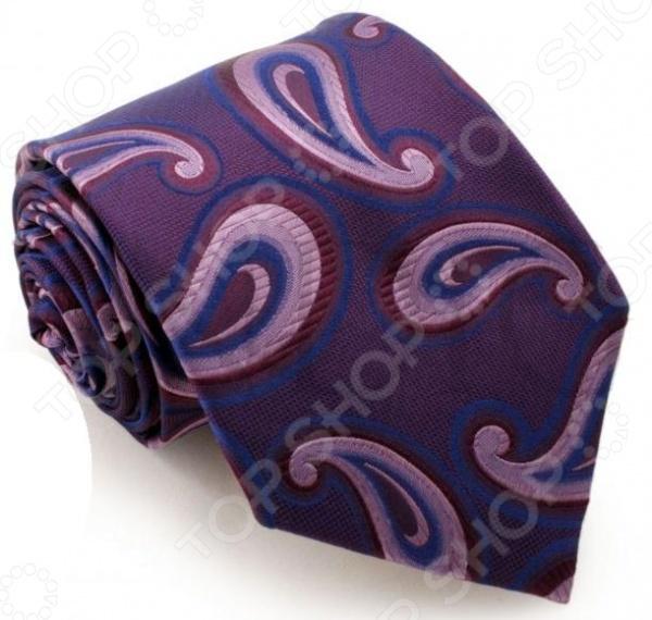Галстук Mondigo 44029Галстуки. Бабочки. Воротнички<br>Галстук Mondigo 44029 завершающий штрих в образе солидного мужчины. Сегодня классический стиль в одежде приветствуется не только на работе в офисе. Многие люди предпочитают в качестве повседневной одежды костюм или рубашку с галстуком. Мужчина, выбирающий такой стиль в одежде, всегда выделяется среди окружающих и производит положительное первое впечатление. Кроме того, один и тот же галстук можно носить по-разному каждый день. Достаточно выбрать один из многочисленных типов узлов: аскот, балтус, кент, пратт и многие другие. Кстати, в интернете есть сайты, которые случайным образом предлагают вариант узла удобно, когда трудно определиться с выбором . Галстук изготовлен из шелка. Ткань довольно прочная, приятная на ощупь и отличается роскошным блеском. Сшит с применением лазерного метода обработки швов.<br>