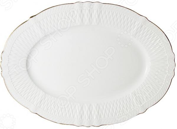 Блюдо овальное Colombo «Бьянка»Сервировочные блюда и тарелки<br>Готовьте с удовольствием! Владение искусством кулинарии это умение не только вкусно готовить, но и красиво преподносить кулинарные шедевры. Очень важную роль играет, конечно же, посуда. Именно она является обрамлением блюда, его гармоничным продолжением. Посуда должна красиво дополнять пищу, подчеркивать ее аппетитность, изысканность и отменный вкус самой хозяйки. Блюдо овальное Colombo Бьянка это идеальное решение для вашего стола. Изящное и практичное изделие, которое подойдет для сервировки самых разнообразных блюд: горячего, холодных закусок, сырных, колбасных и рыбных нарезок, фруктовых и овощных ассорти, кондитерских изделий и пр.  Качественно, практично, красиво! Блюдо изготовлено из высококачественного фарфора, который обладает массой полезных качеств:  Не содержит токсичных веществ и тяжелых металлов;  Отлично взаимодействует с продуктами питания;  Подходит для длительного хранения продуктов;  Легко очищается от загрязнений;  Не впитывает запахи;  Имеет изящную гладкую структуру и красивейший молочный оттенок. Блюдо рекомендуется очищать вручную теплым раствором моющего средства. Во время мытья не используйте жесткие губки и чистящие абразивные вещества. Хозяйку порадуют не только достойные потребительские качества изделия, но и его великолепный дизайн. Блюдо имеет небольшие бортики, за счет чего его легко удерживать и переносить. Благодаря изящному рифленому орнаменту и золотистой кайме оно станет настоящим украшением обеденного стола!<br>