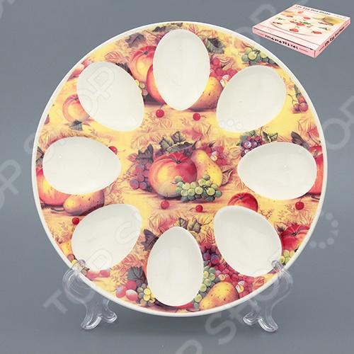 Менажница для яиц Elan Gallery «Натюрморт»Менажницы. Пашотницы<br>Менажница для яиц Elan Gallery Натюрморт станет украшением вашего стола. Красивое оформление стола как праздничного, так и повседневного это целое искусство. Правильно подобранная посуда это залог успеха в этом деле. Такая менажница придется по вкусу даже самым требовательным хозяйкам и придаст особый шарм и очарование сервируемому столу. Менажница это весьма популярное блюдо для сервировки стола. Удобство менажниц оценили многие хозяйки, ведь на одном блюде вы сможете разместить сразу несколько фаршированных яиц и подать их на стол.<br>