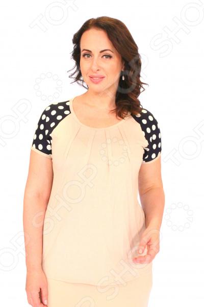 Блуза Матекс «Жемчужное чудо». Цвет: бежевыйБлузы. Рубашки<br>Блуза Матекс Жемчужное чудо это легкая и нежная блуза, которая поможет вам создавать невероятные образы, всегда оставаясь женственной и утонченной. Благодаря отличному дизайну она скроет недостатки фигуры и подчеркнет достоинства. Блуза прекрасно смотрится с брюками и юбками, а насыщенный цвет привлекает взгляд. В этой блузе вы будете чувствовать себя блистательно как на работе, так и на вечерней прогулке по городу. Свободный крой и универсальная длина до середины бедра делают блузу одеждой на все случаи жизни, а удобные короткие рукава скрывают полноту плеч. Спереди изделия сделаны вытачки, в качестве декоративного элемента. На фотографии блуза представлена с юбкой Венера . Блуза изготовлена из мягкой ткани 95 вискоза, 5 полиэстер, вставки: 65 вискоза, 30 полиэстер, 5 лайкра , благодаря чему материал не скатывается и не линяет после стирки.<br>