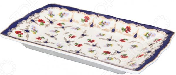 Тарелка под масло Elan Gallery «Цветочек»Масленки и паштетницы<br>Тарелка под масло Elan Gallery Цветочек изящное и практичное дополнение кухонной утвари. Тарелка подойдет не только для сервировки масла, но и для колбасных, сырных изделий, лимона, оливок, рыбной нарезки, канапе и пр. Красочный дизайн в сочетании с приятной цветовой гаммой делает ее настоящим украшением кухонного интерьера и обеденного стола. Если вы решили создать особую атмосферу во время завтрака, чаепития или праздничного застолья, то для этих целей тарелка подойдет идеально! Достоинства изделия:  Универсальность и практичность;  Изящный дизайн;  Приятная расцветка;  Высококачественный материал керамика;  Оригинальная форма. Качество: Тарелка выполнена из высококачественной керамики, которая обладает широчайшим спектром достоинств. Она не содержит вредных компонентов и прекрасно взаимодействует с продуктами, легко очищается и не впитывает запахи. Керамика устойчива к повышенным температурам и воздействию различных химических веществ. Во время мытья не рекомендуется применять чистящие средства с абразивными компонентами. Не использовать тарелку в микроволновой печи.<br>