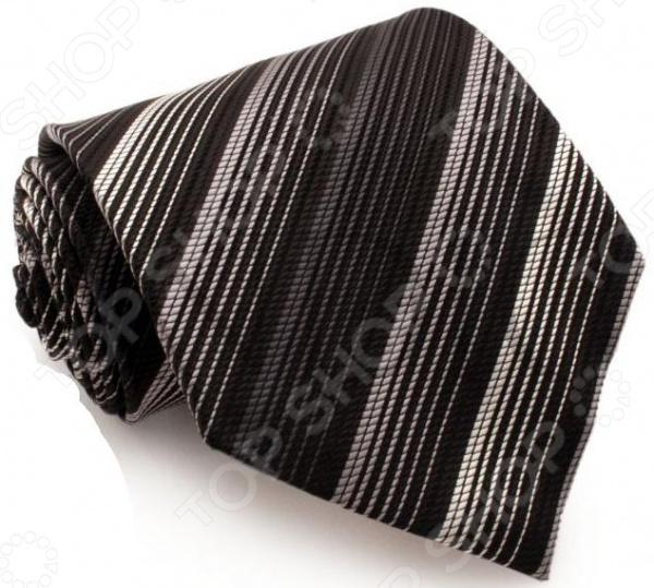 Галстук Mondigo 44010Галстуки. Бабочки. Воротнички<br>Галстук Mondigo 44010 завершающий штрих в образе солидного мужчины. Сегодня классический стиль в одежде приветствуется не только на работе в офисе. Многие люди предпочитают в качестве повседневной одежды костюм или рубашку с галстуком. Мужчина, выбирающий такой стиль в одежде, всегда выделяется среди окружающих и производит положительное первое впечатление. Кроме того, один и тот же галстук можно носить по-разному каждый день. Достаточно выбрать один из многочисленных типов узлов: аскот, балтус, кент, пратт и многие другие. Кстати, в интернете есть сайты, которые случайным образом предлагают вариант узла удобно, когда трудно определиться с выбором . Галстук изготовлен из шелка. Ткань довольно прочная, приятная на ощупь и отличается роскошным блеском. С обратной стороны галстук прострочен шелковой ниткой, что позволяет регулировать длину изделия.<br>
